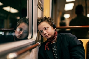 we-are-the-best-2013-003-girl-with-headphones-on-train